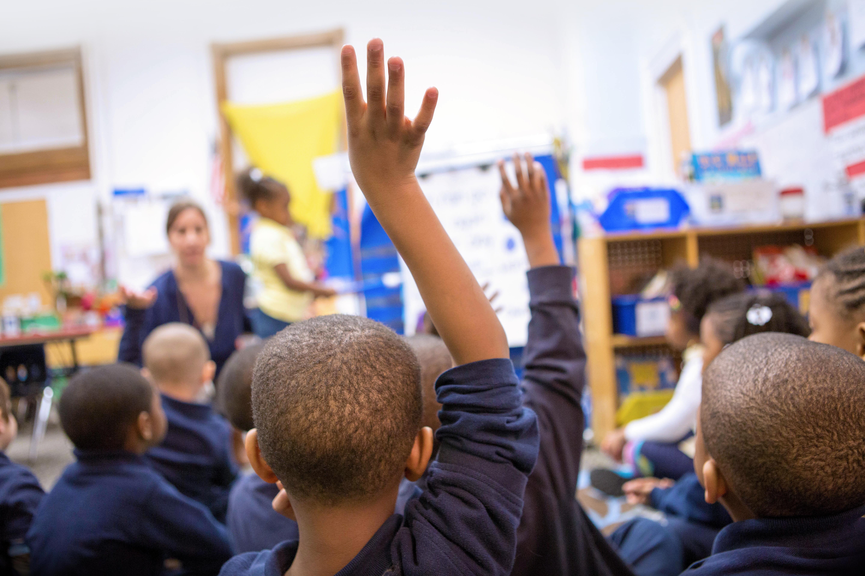 African American Boy Raising Hand