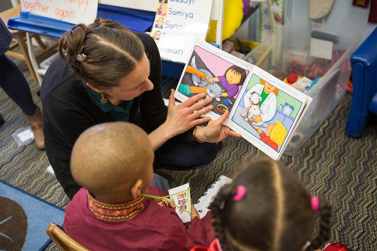 Kids Reading with Teacher