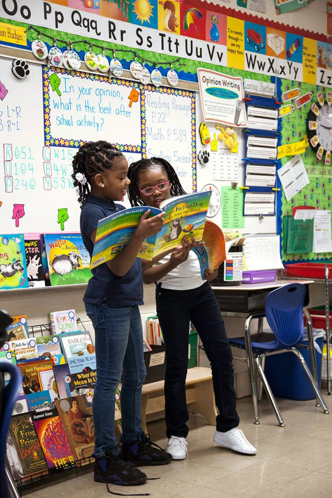 Two girls reading in Chicago Classroom