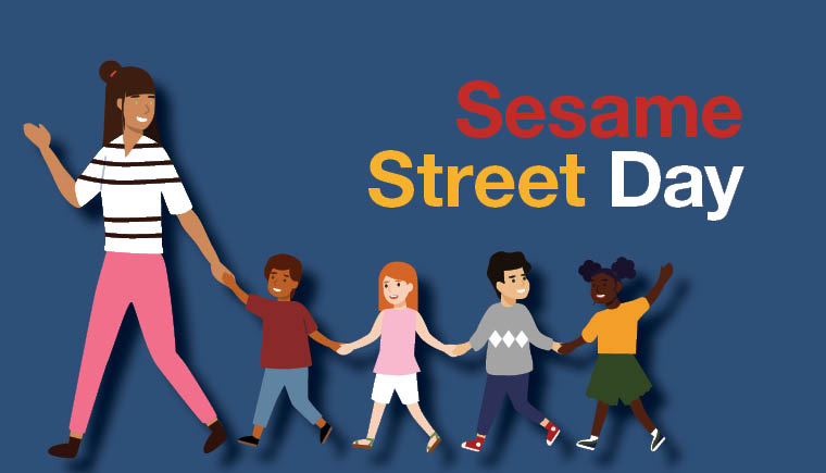 Sesame Street Day in multicolored font. Underneath is an image of a teacher holding the hand of her line leader.