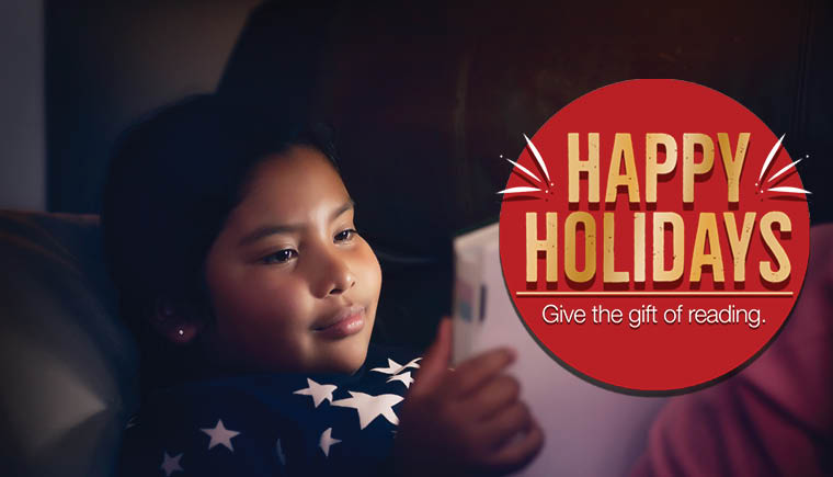 """Latine child reading book with a red circle overlayed. Text reads """"Happy Holidays. Give the gift of reading"""""""